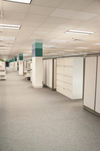 Office interior with cubicle layout.